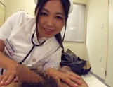Adorable Japanese nurse Aira Masaki teases cock in handjob picture 8