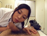 Adorable Japanese nurse Aira Masaki teases cock in handjob picture 9