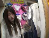 Exquisite Saki Kobashi engulfs cock in a clothing store picture 13