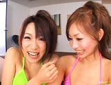 Hot Asian Kanako and friend get a jizz bomb while they are French kissing picture 3