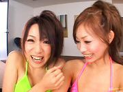 Hot Asian Kanako and friend get a jizz bomb while they are French kissing