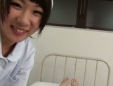 Sweet teen Japanese nurse with shaved pussy rides her patient's cock picture 15