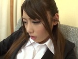 Sweet office lady Saki Hatsuki gives a foot job and rides cock picture 6