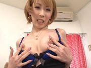 MILF Aya Kisaki dresses up to fuck herself with a dildo