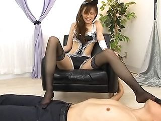 Enticing Japanese AV model gives one hot footjob