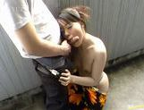 Young Japanese hottie sucks off a wanker in the outdoors