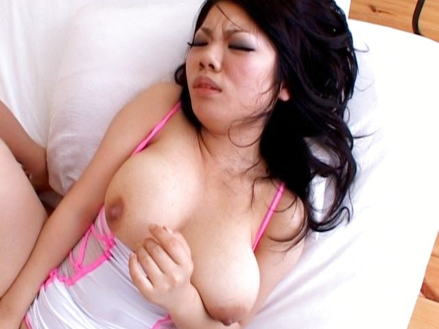Hot Asian babe has a huge set of hooters