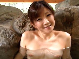 Ai Komori hot mature Asian babe sucks cock in public