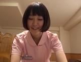 Naughty Asian nurse Yuu Shinoda gives a foot job and bounces on cock
