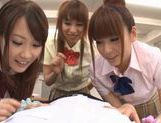 Three sweet Japanese school girls suck on one throbbing cock and eat cum picture 12