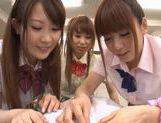 Three sweet Japanese school girls suck on one throbbing cock and eat cum picture 14