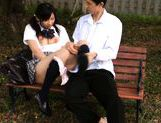 Cute schoolgirl Nana Ogura plays with herself in the park. picture 13