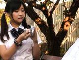 Cute schoolgirl Nana Ogura plays with herself in the park. picture 2