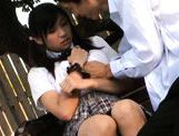 Cute schoolgirl Nana Ogura plays with herself in the park. picture 8