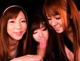 Cute Asian schoolgirls giving a blowjob