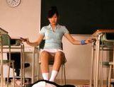 Sexy schoolgirl Nana Ogura msturbates a big cock with her feet.