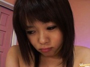 Nao lovely Asian teen with shaved pussy gets a dildo penetration
