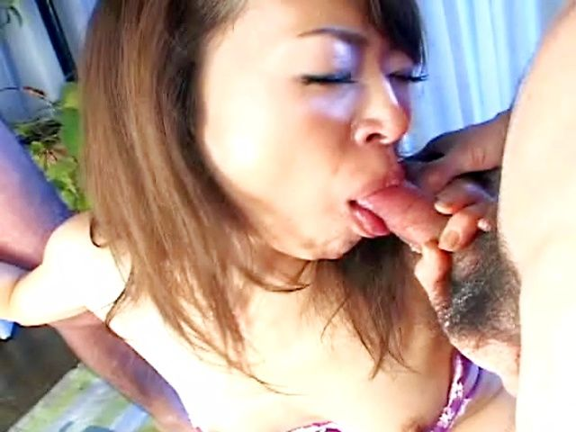 Japanese AV model gives a double blowjob