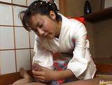 Kimono clad Japanese MILF Megumi Tsuchida wanks off a dick picture 12