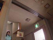 Tempting tavern clerk Rina Araki sucks cock and fondles it with tits