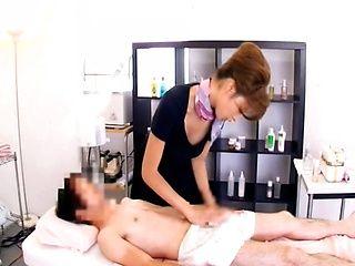 Mature massage therapist Japanese woman jerks off a cock