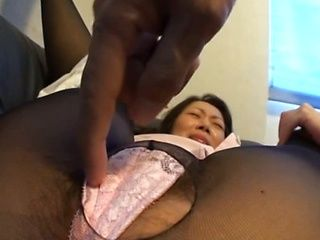 Milf Japanese black stocking wearing woman is having pleasurable amature sex with a man.