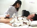 Sexy nurse Saki Budou gives a quick handjob to her male patient picture 13