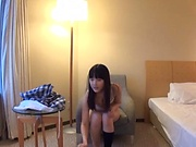 Japanese girl removes lingerie to pose kinky on cam