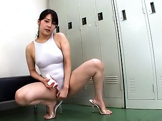 Japanese AV Model plays with toys in both her holes