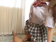 Cute Japanese teen expertly gives a mind blowing handjob