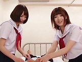 Beautiful schoolgirls expertly tug and blow a hard sweet pole