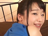 Smiling teen with a nice ass Himekawa Yuuna gives a footjob