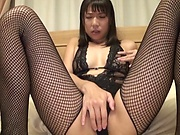 Kinky Asian beauty gets both her holes filled with cum