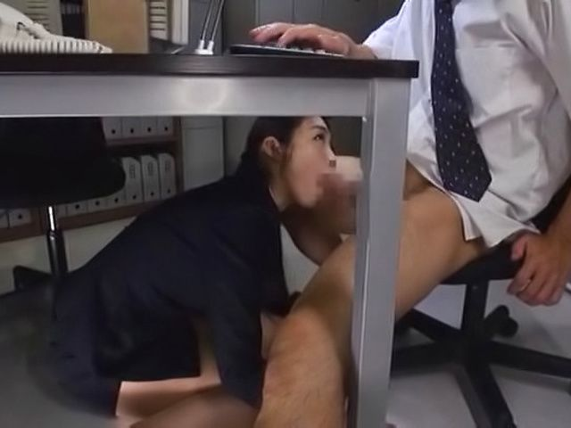 Sweet minx gives head in her sexy office suit