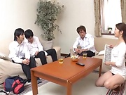Mature Asian minx in work clothes gets foursome action