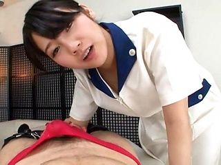 Gorgeous Japanese nurse Mitsuna Rei touches the guy's dick