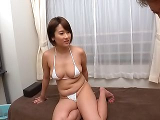 Spicy hot milf teases while in a sexy mini bikini