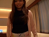 Mika Konishi showcases her sexy legs while in a mini skirt