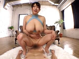 Stunning model with giant boobs Yuzuki Marina enjoys a tit fuck