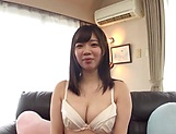 Busty Japanese minx is being naughty picture 12