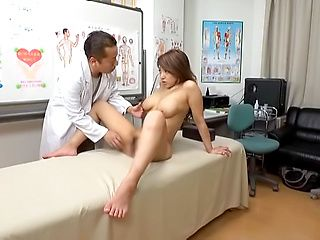 Busty Japanese woman fucked by doc during gyno control
