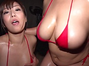 Asian milfs sharing cock in perfect threesome at the gym