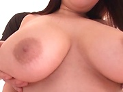 Busty Japanese milf Yuzuki Marina masturbates and gets toyed