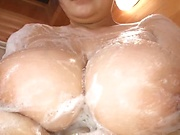 Busty babe is rubbing her hairy pussy