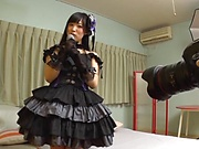 Sweet Japanese teen in a black dress enjoys hardcore cosplay