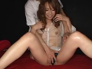 Cute Asian bewitching beauty enjoys fisting