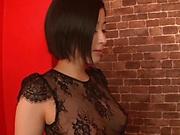 Seductive brunette is wearing sex dress