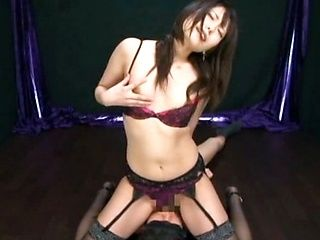 Gorgeous Japanese cougar in sexy lingerie bounces on a hard rod