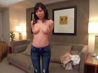 Luscious Japanese milf entertains herself using a vibrator