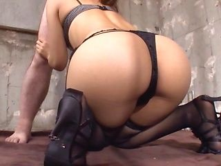 Brunette in high heels is sucking dick